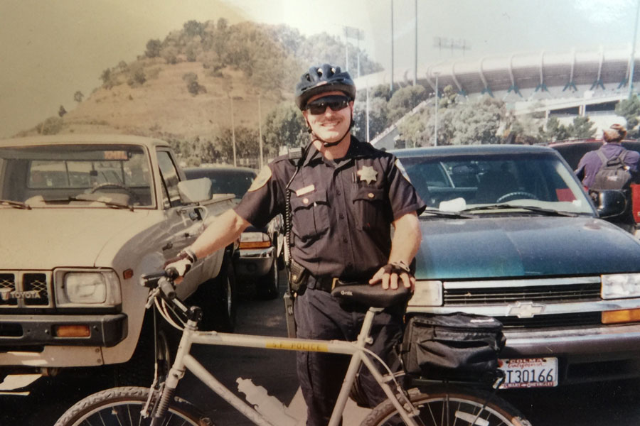 LAA lawyer Chuck Easton was a police officer in his earlier years. In this photo he poses outside Candlestick stadium in San Francisco.
